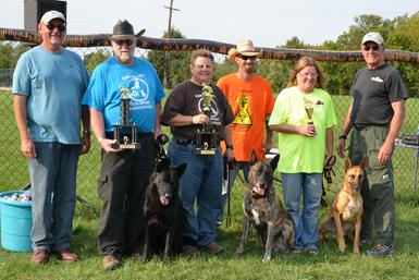 Cheryl Carlson & her Dutch Shepherd �Becker� winning the MI K-9 Challenge Protection Dog Tournament in 2012.  This picture is more amazing as all the dogs that placed in the Advanced Division (1st-Dutch Shepherd �Becker�, 2nd-German Shepherd �Paladin� & 3rd-Belgian Malinois �Elphaba�) were bred by Cher Car Kennels!