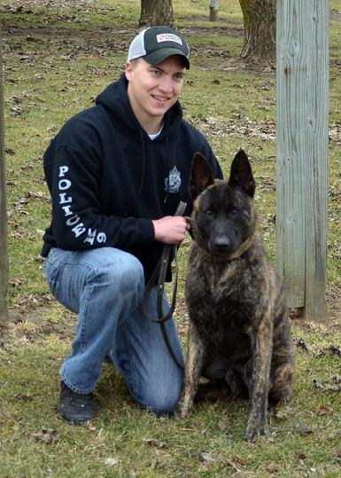 Orleans County Vermont Sheriff�s Department Deputy Tyler Jacobs with his new PSD K9 Cher Car�s Jonah