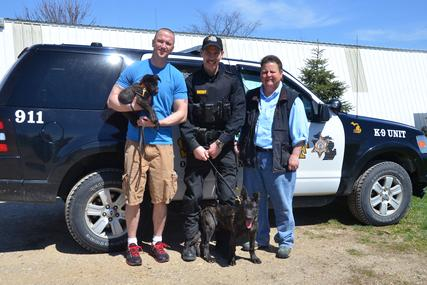 Osceola County, Michigan Sheriff's Department Deputy Jed Avery and Deputy Mark Moore with their future PSD K9 Dutch Shepherd puppies and breeder Cheryl Carlson of Cher Car Kennels.