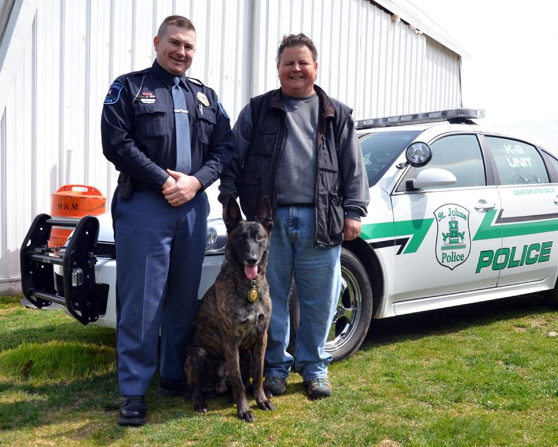 "Officer Ben Helms and purpose PSD K9 ""Duke"" of the St. Johns, Michigan Police Department with breeder/trainer Cheryl Carlson"