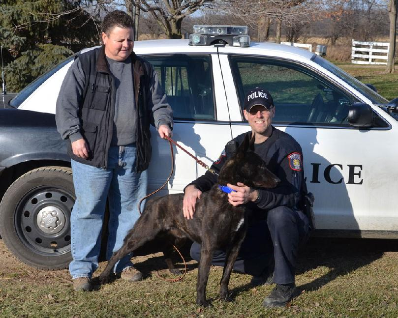 "Police Chief Matt Balsley and dual purpose PSD K9 CH Cher Car's Sir Reggie aka �Reggie� of the Morrice, Michigan Police Department with breeder/trainer Cheryl Carlson of Cher Car Kennels.  We are uncertain of how many Dutch Shepherd breed Champion Police Service Dogs there are, but suspect ""Reggie"" might be the first of his breed!"